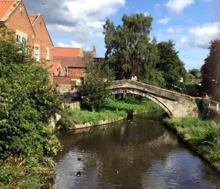 the stream runs through the town